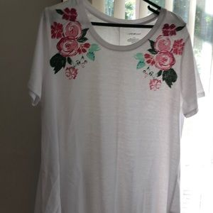 White top with flowers on shoulders
